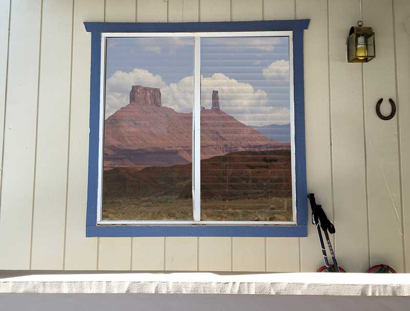 A scene from north of Moab Utah (passing for Monument Valley) reflected in front window of my Arizona home)