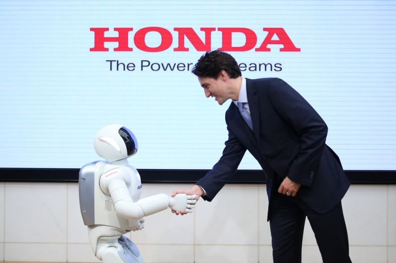 Justin Trudeau greets a robot, image from Paleofuture blog http://paleofuture.gizmodo.com/more-like-justin-trudeau-bot-right-1778528399